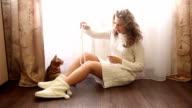 Girl plays with a Bengal cat. video