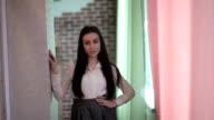Girl poses in the doorway video