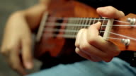 Girl practicing ukulele,Close-up video
