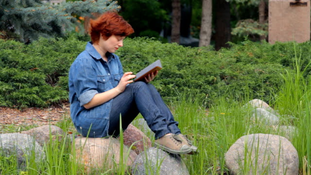 Girl read e-book on the pond video