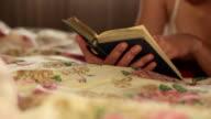girl reading a book video