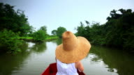 Girl relaxing in boat on  wetlands video