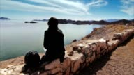 Girl relaxing observing the sea atthe road video