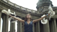 Girl Releasing A Pigeons From Her Arms video
