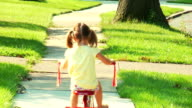 Girl rides Tricycle Away video