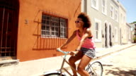 Girl riding a bike on the street video