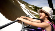 Girl riding a chairlift in summer video