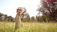 SLO MO DS Girl running across a summer meadow video