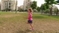 Girl running at playground video