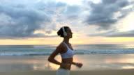 Girl Running At Sand Near Water video