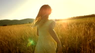 MS TS SLO MO Girl Running In Field At Sunset video