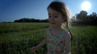 Girl Running In The Meadow At Sunset video