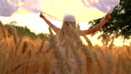 HD SUPER SLOW-MOTION: Girl Running Through Field With Sheet video