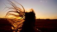 SLO MO Girl running toward the sun video
