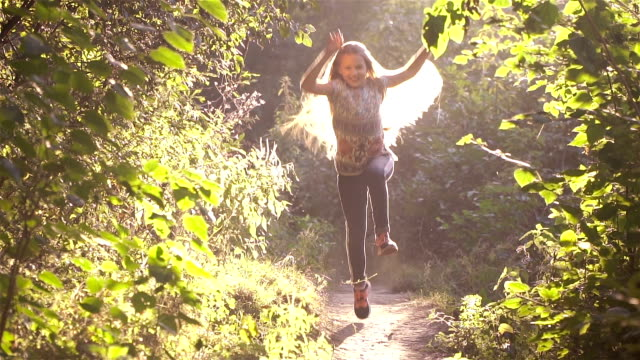 Girl runs along the forest path video