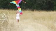 Girl runs to camera with kite video