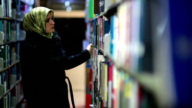 Girl searching for books video