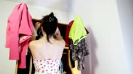 Girl searching for clothes video