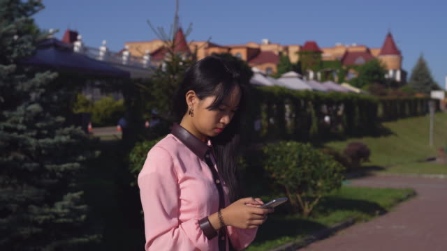 Girl sharing in social net on telephone outdoors video
