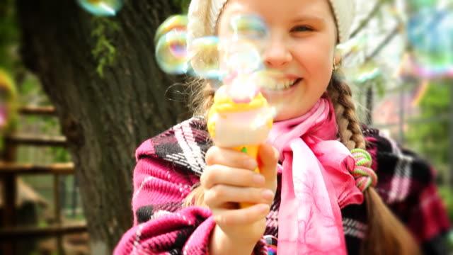 Girl shooting with bubbles gun - HD, NTSC video