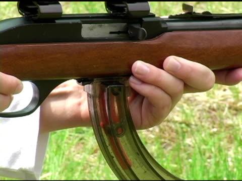girl shoots 22 rifle video