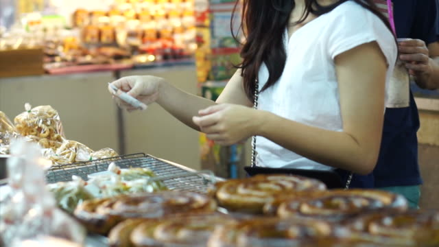 CHIANGMAI, THAILAND- April 2015: girl shopping and paying cash in Asia local Market video