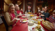 POV girl showing funny dance to family at Christmas dinner video