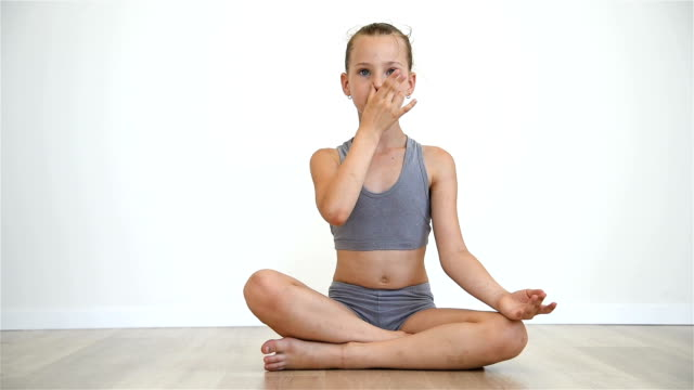 Girl Sitting In Lotus Position video