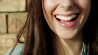 Girl smiling on the wind - slow motion video