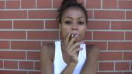 Girl smoking cigarette. video
