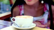 girl sniffs the aroma of freshly brewed coffee video