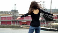 Girl spinning in slow motion video