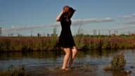 Girl splashing on river bank video