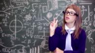 Girl standing by blackboard video