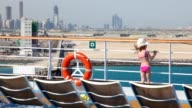 Girl stands on deck of cruise liner video