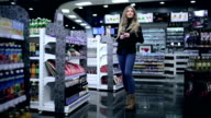 Girl steals candy from store. video