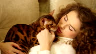 Girl stroked his Bengal cat. video