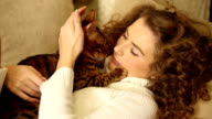 Girl stroking and kissing her Bengal cat. video