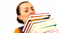 Girl struggling with stack of books video