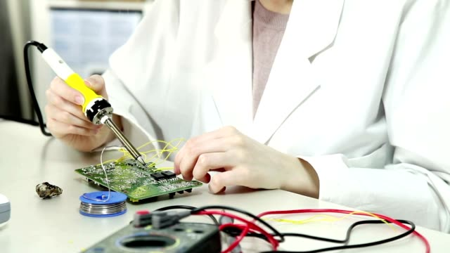 Girl student in the laboratory of electronics university video