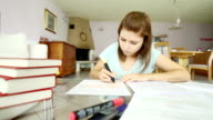 Girl studying and underlining important facts video