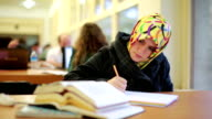 Girl studying in library video
