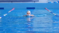 Girl Swimmer Swims In a Pool video