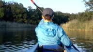 Girl swims on a kayak video