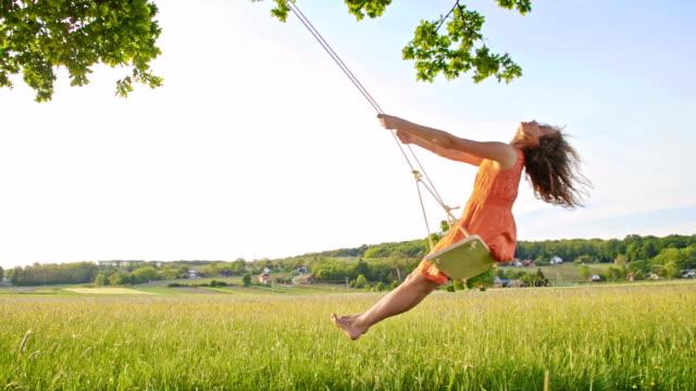 SLO MO Girl swinging on a tree swing video