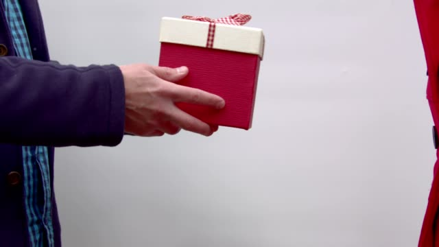A girl takes a gift from the hands of a man video