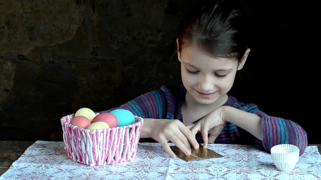 Girl takes out of basket of eggs and decorate for Easter video