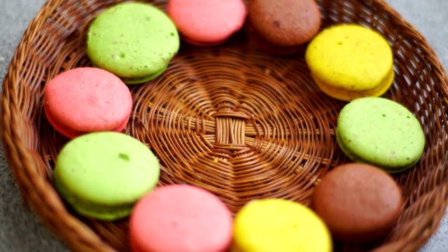 girl takes yellow biscuits macaroon from plates video