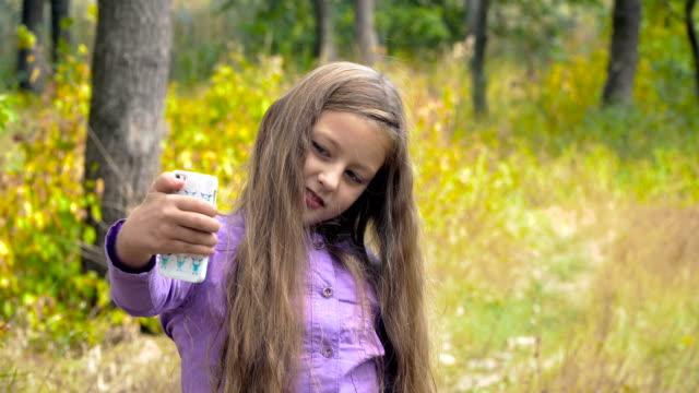 Girl taking self portrait video