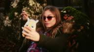 Girl taking selfie. video